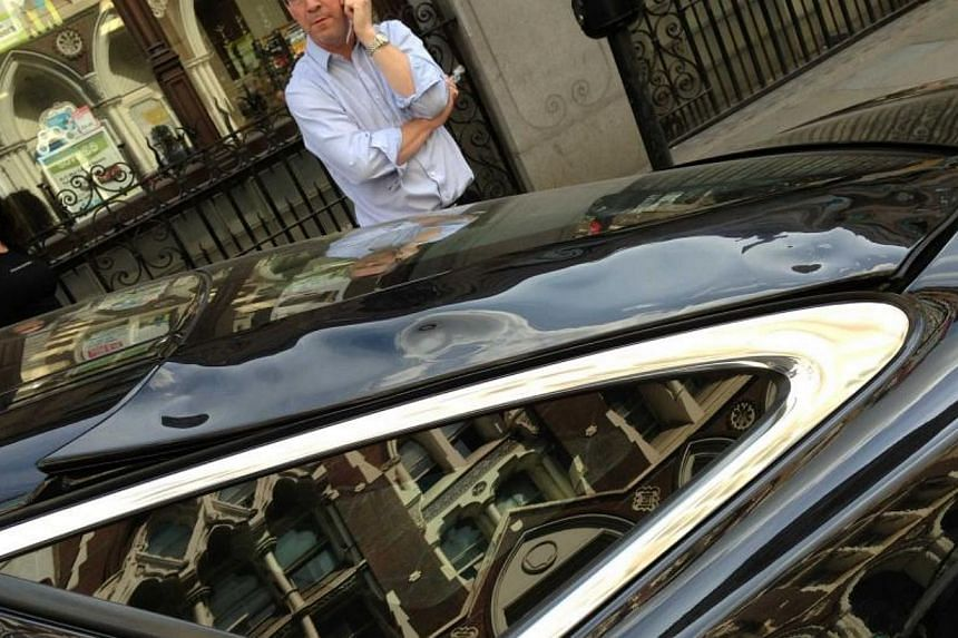 Local businessman Martin Lindsay said he was distraught when he returned to his parked car near the tower in London's financial district to find the car's panels had warped along one side, while the wing mirror and Jaguar emblem on the front of the c