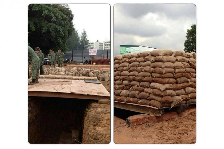 Combat engineers and men from the Explosive Ordnance Disposal (EOD) team from the Singapore Armed Forces (SAF) sucessfully detonated a war-relic at a Seletar construction site around noon on Tuesday. -- PHOTO: THE SINGAPORE ARMY/ FACEBOOK