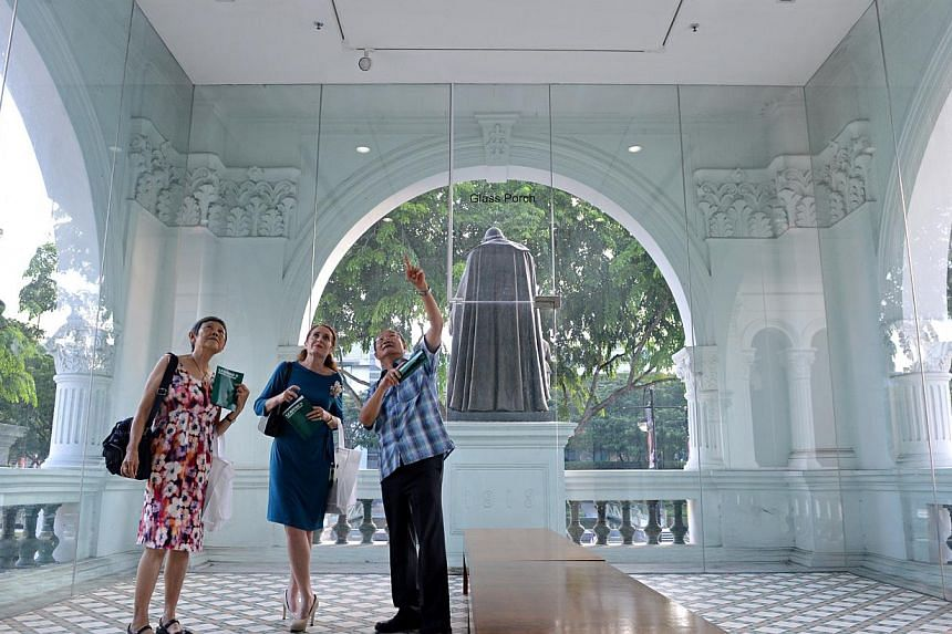 Mr Foo Chee Cheng (right), 70, former History teacher at St Joseph's Institution (SJI), gives a guided tour about the heritage of the former SJI campus to Mrs Louise Grant (centre), Principal of SJI International Elementary School, and Mrs Susi Teo,