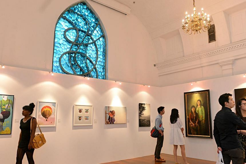 An art exhibition in the chapel at the Singapore Art Museum featuring works of former St Joseph's Institution (SJI) students. SJI launched a guide booklet on Tuesday, Sept 3, 2013, for visitors to navigate their way through its former campus in Bras