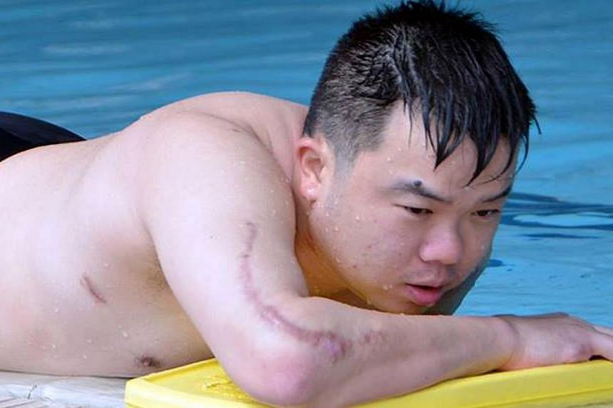 ME2 Jason Chee during his pool-based physiotherapy, in a photo posted on the Navy's Facebook page. Netizens wished him well, describing his fighting spirit as an inspiration.