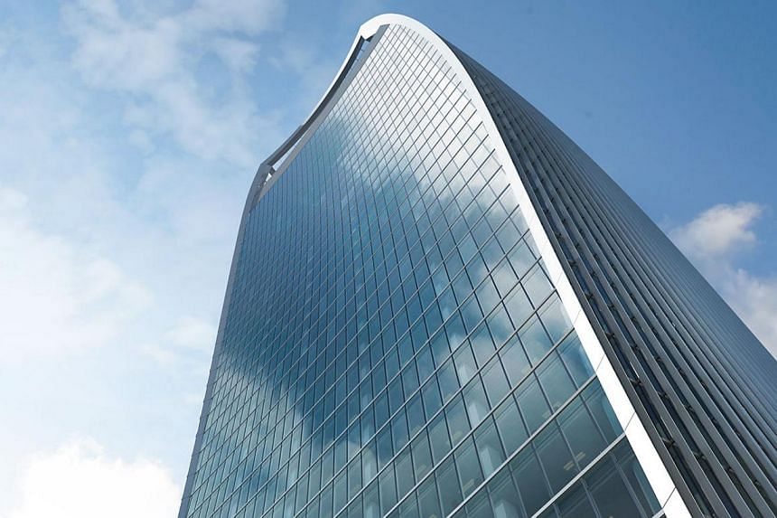 An artist impression of 20 Fenchurch Street - nicknamed the Walkie Talkie because of its flared shape. A British property developer said Tuesday it was investigating after rays deflected by the skycraper melted the side of a businessman's luxury Jagu