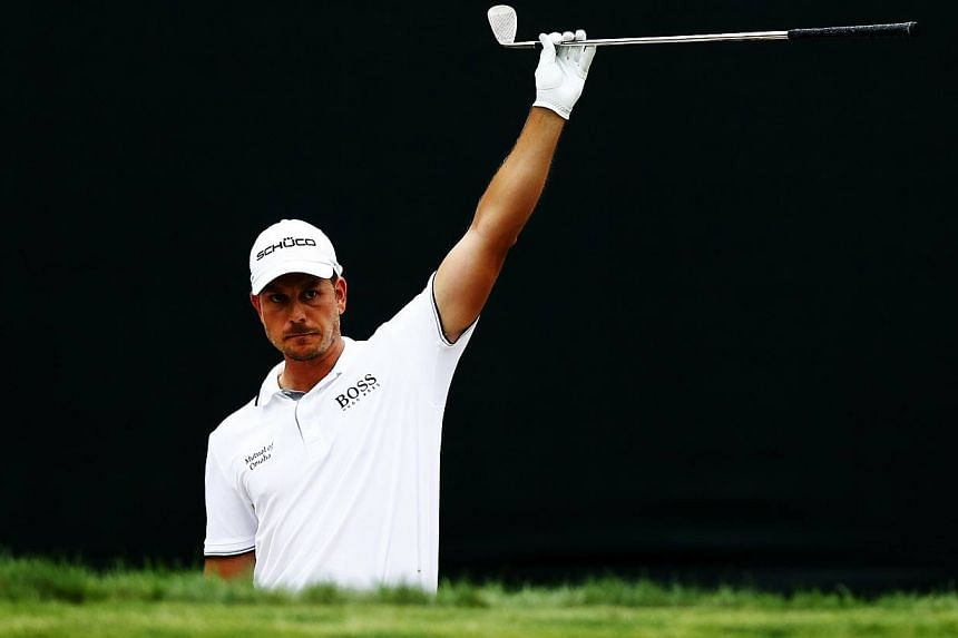 Henrik Stenson of Sweden celebrates after playing a shot from a bunker into the hole on the 17th green for birdie during the final round of the Deutsche Bank Championship at TPC Boston on Sept 2, 2013, in Norton, Massachusetts.Stenson won the D