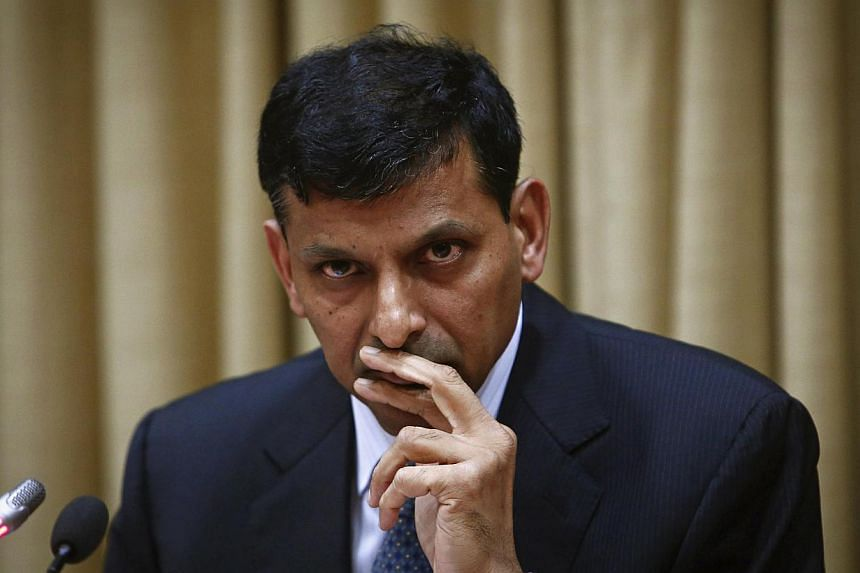 Mr Raghuram Rajan, newly appointed governor of the Reserve Bank of India (RBI), listens to a question during a news conference at the bank's headquarters in Mumbai, Sept 4, 2013. Mr Rajan, a suave, unflappable University of Chicago economist, will st