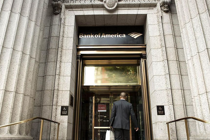 A man enters a Bank of America Aug 7, 2013 in Washington, DC. Bank of America said on Tuesday it had agreed to sell its stake in China Construction Bank to the bank, exiting an investment it made eight years ago. -- FILE PHOTO: AFP
