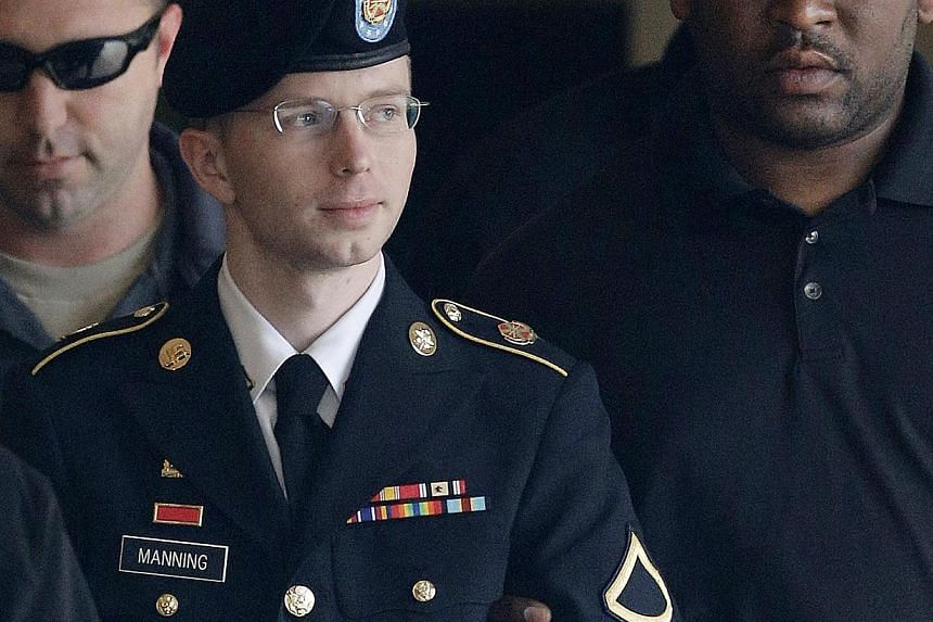 Army Private First Class Bradley Manning is escorted to a security vehicle outside a courthouse in Fort Meade, Maryland, after a hearing in his court martial on Aug 20, 2013. Lawyers for Manning, now known as Chelsea Manning, filed a request for a pa
