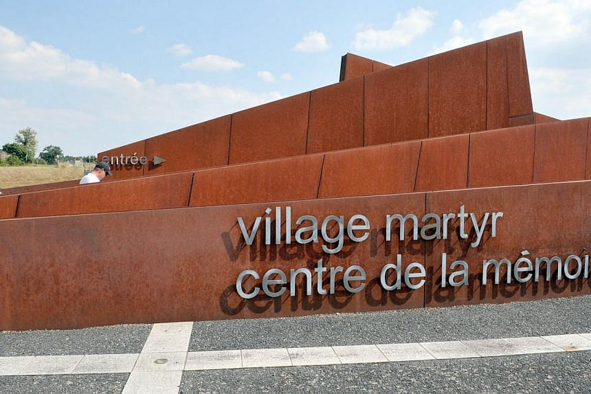 View on Aug 30, 2013 shows the entrance of the memorial at the cemetery of the martyr village of Oradour-sur-Glane, central France, where 642 citizens including 500 women and children were killed locked up in a church intentionally set on fire by a S