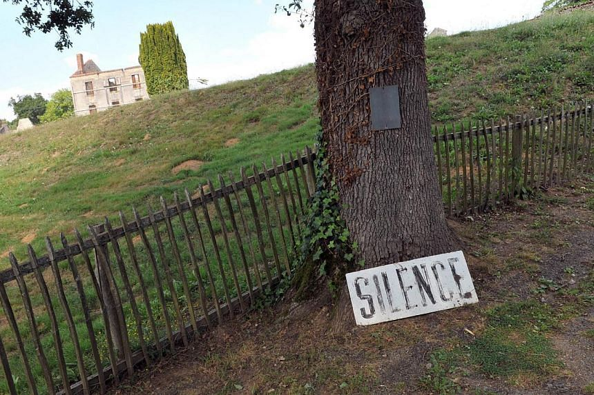 View dated on Aug 30, 2013 of the entrance of the site in the village of Oradour-sur-Glane, central France, where 642 citizens including 500 women and children were killed locked up in a church intentionally set on fire by a SS division on June 10, 1