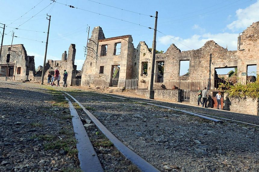 View dated on Aug 30, 2013 shows the martyr village of Oradour-sur-Glane, central France, where 642 citizens including 500 women and children were killed locked up in a church intentionally set on fire by a SS division on June 10, 1944. German Presid