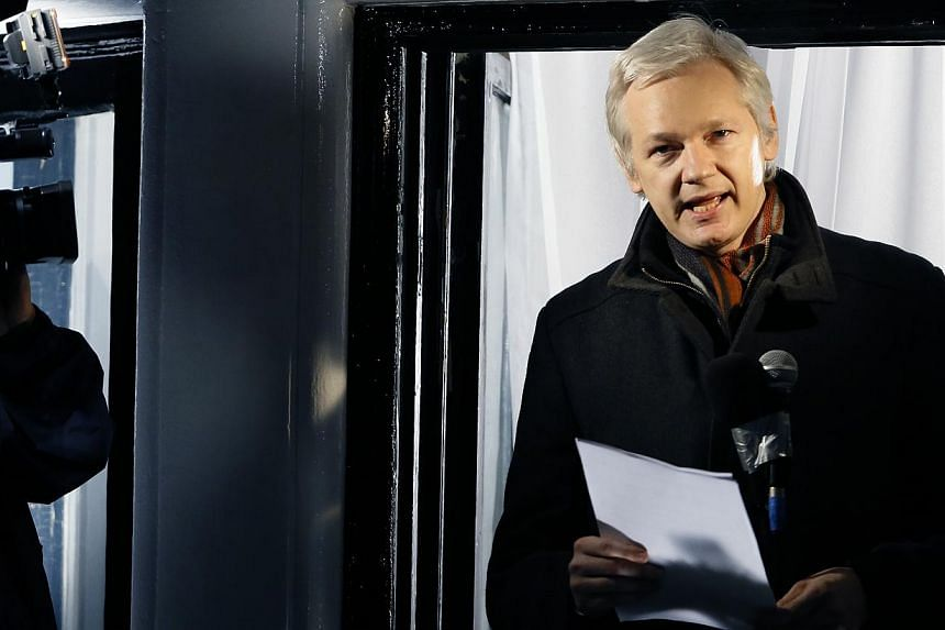 Julian Assange, fugitive founder of WikiLeaks as he speaks to the media and members of the public from a balcony at the Ecuadorian Embassy in London on Thursday, Dec 20, 2012. Assange has been named as a juror in London's Raindance Film Festival, tho