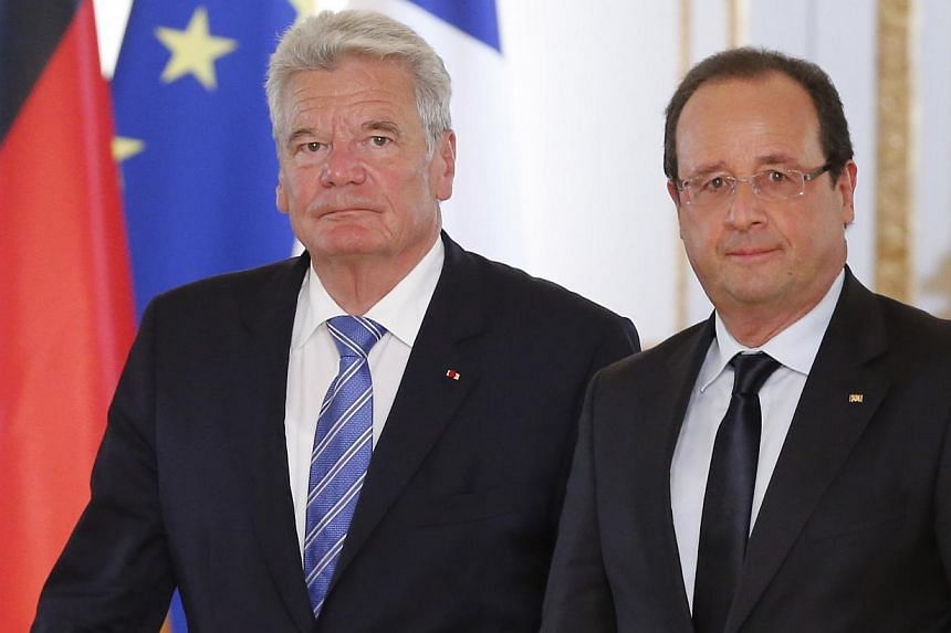 German President Joachim Gauckand (left), arrives at joint news conference with French President Francois Hollande following their meeting at the Elysee Palace, Paris, on Tuesday, Sept 3, 2013. Gauckand is visiting France on Wednesday and Thursday an