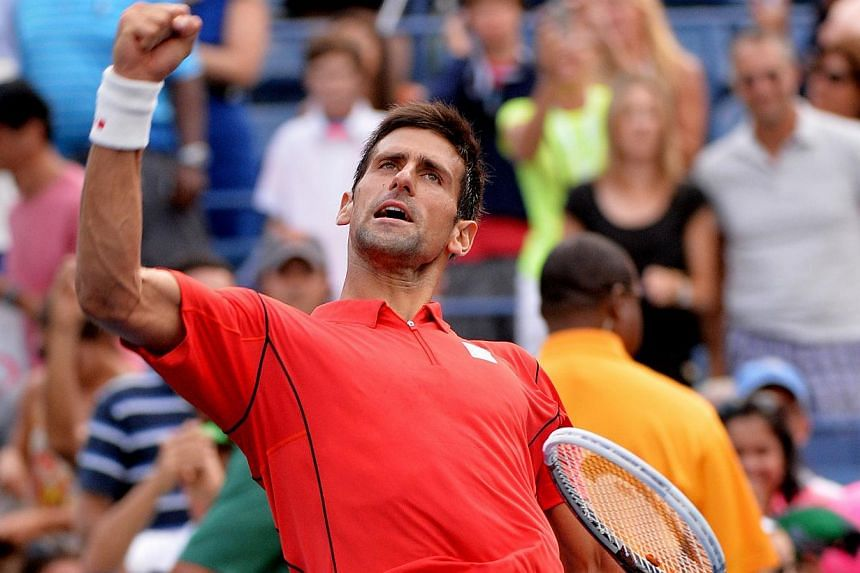 Novak Djokovic of Serbia celebrates his 6-3, 6-0, 6-0 win over Marcel Granollers of Spain during their 2013 US Open men's singles match at the USTA Billie Jean King National Tennis Center on Sept 3, 2013 in New York. -- PHOTO: AFP