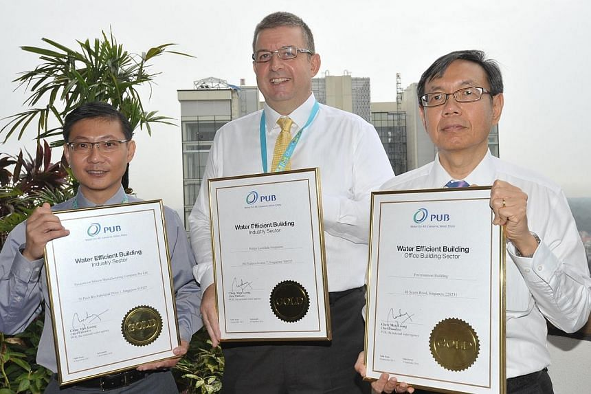 The three Water Efficient Building (Gold) Certification winners. (From left: Mr Collin Tan, SSMC; Mr James Day, Philips Lumineds Singapore and Mr Terence Siew, Environment Building) -- PHOTO: PUB