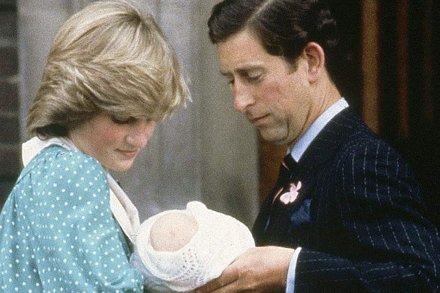 In this June 22, 1982, file photo, Britain's Prince Charles, Prince of Wales, and wife Princess Diana take home their newborn son Prince William, as they leave St Mary's Hospital in London. -- FILE PHOTO: AP