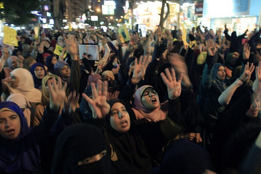 Supporters of Egypt's ousted President Mohammed Mursi chant slogans during a protest to commemorate two months since he was ousted, in Cairo, Egypt, Tuesday, Sept 3, 2013. -- PHOTO: AP