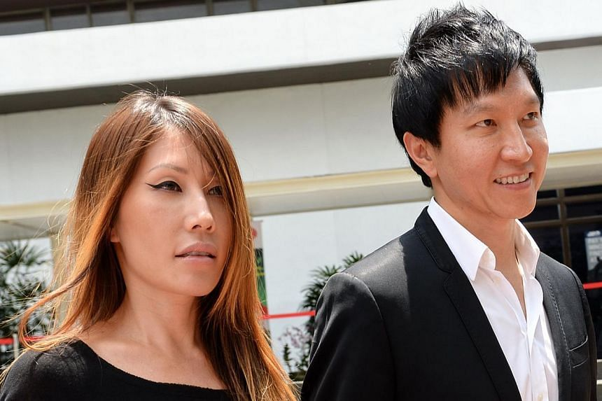 City Harvest Church co-founders Ho Yeow Sun (left) andKong Hee at the Subordinate Courts on Aug 28, 2013. Ms Howas to receive a $2.2 million apartment in New York while she was recording her album there. Her United States manager Justin H