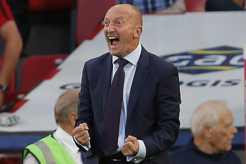 Crystal Palace manager Ian Holloway celebrates at the final whistle after winning their English Premier League football match against Sunderland at Selhurst Park on Aug 31, 2013.Holloway will serve a two-match touchline suspension after accepti