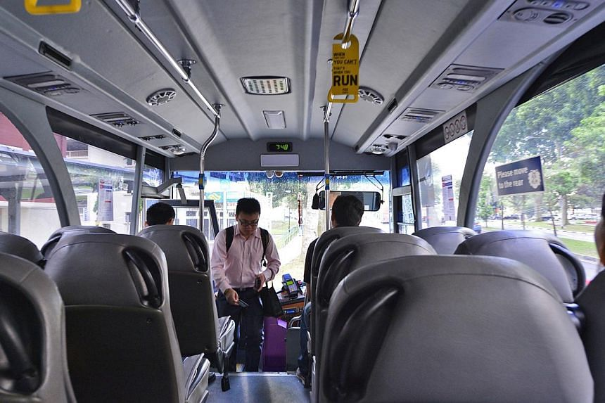 All of the commuters who spoke to The Straits Times praised the City Service 651 for the convenience and comfort the ride offers them. The service starts from Jurong West Avenue 3 and takes the Ayer Rajah Expressway to Marina Boulevard. -- ST PHOTO:
