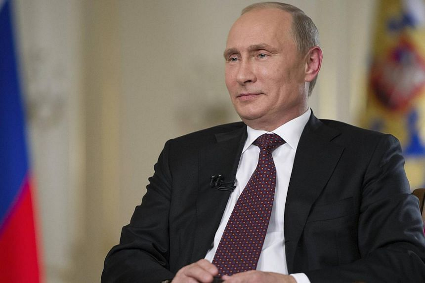 Russian President Vladimir Putin gives an interview at the Novo-Ogaryovo state residence outside Moscow on Tuesday, Sept 3, 2013. Mr Putin on Wednesday, Sept 4, 2013, struck a more conciliatory tone ahead of this week's G-20 summit, saying Mosco