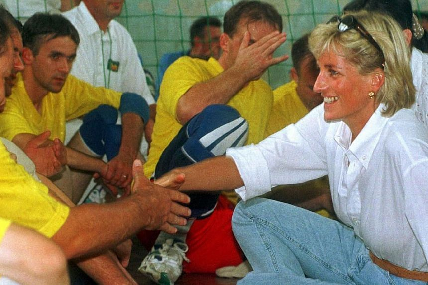 Britain's Diana, Princess of Wales, meets with members of a Zenica volleyball team who have suffered injuries from mine on Aug 9, 1997. Princess Diana is the deceased celebrity many Americans would want to bring back to life while most men would pref