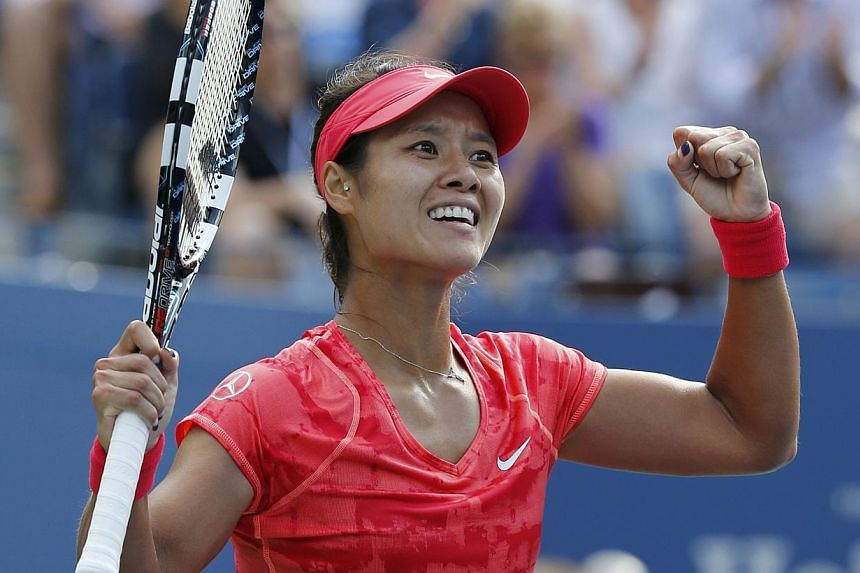 Li Na of China celebrates after defeating Ekaterina Makarova of Russia at the US Open tennis championships in New York on Sept 3, 2013. -- PHOTO: REUTERS