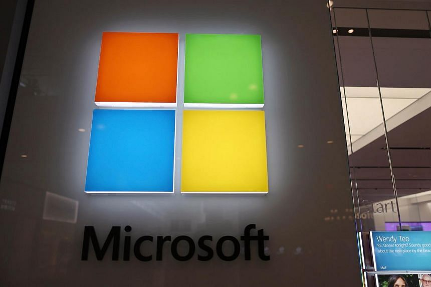 A sign is seen on the wall outside of a Microsoft store in the Dadeland Mall as Microsoft announces it will be buying Nokia Corp's line-up of smart phones on Sept 3, 2013 in Miami, Florida. -- PHOTO: AFP