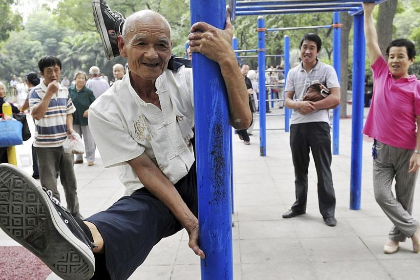 Yang Shiguang, 77, performs stunts at a park in Xi'an, Shaanxi province on Tuesday, Sept 3, 2013. Yang has been a member of a stunt performance club since 2007, after retiring from a research institution. See more pictures from around the world in Th
