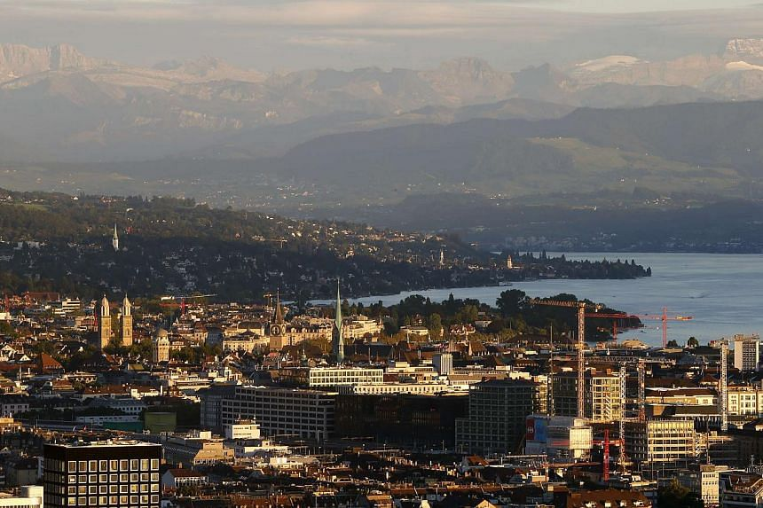 A general view shows the city of Zurich, Lake Zurich and the eastern Swiss Alps on Sept 2, 2013. Switzerland has kept its title as the world's most competitive economy for the fifth year running, though it needs to resist any temptation to protect it