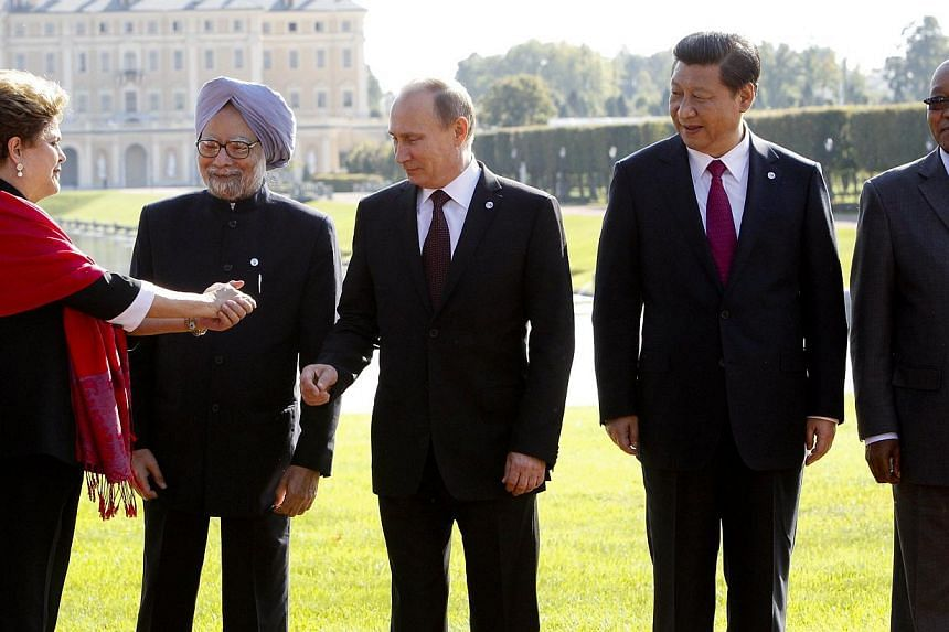 (From left) Brazil's President Dilma Rousseff, India's Prime Minister Manmohan Singh, Russia's President Vladimir Putin, China's President Xi Jinping and South African President Jacob Zuma pose for a photo after the Brics leader's meeting at the G-20