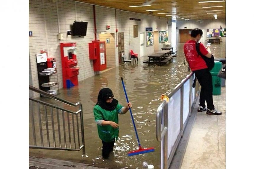 Heavy rain in the morning caused heavy flooding at some parts of the National University of Singapore (NUS) campus on Thursday. -- PHOTO: INTERNET