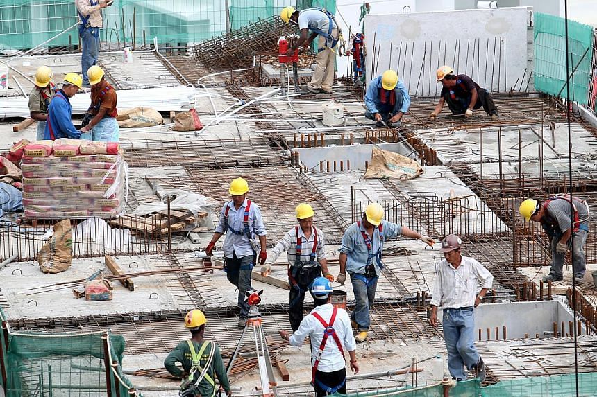 Construction workers at a construction site in Sengkang West Ave on Aug 20, 2012. There were fewer workplace deaths and injuries in the first six months of this year, compared to the same period in 2012, according to latest figures from the Workplace