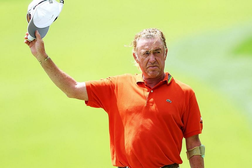Miguel Angel Jimenez of Spain waves to the gallery on the 18th hole during the final round of the 95th PGA Championship on Aug 11, 2013 in Rochester, New York. Former Ryder Cup winner Miguel Angel Jimenez has questioned the appearance of a 13-ye