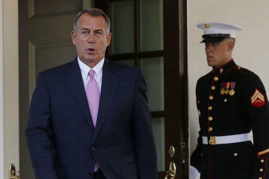 Speaker of the House John Boehner walks out to speak to the press after meeting with US President Obama and bipartisan Congressional leaders in the Cabinet Room at the White House in Washington while discussing a military response to Syria, on Sept 3