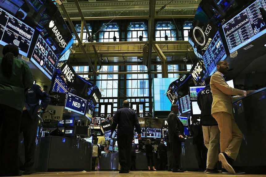 """Traders work on the floor of the New York Stock Exchange on Sept 3, 2013. US economic growth has held firm at a """"modest to moderate"""" pace since July, with activity steady or gaining in most sectors, the Federal Reserve's Beige Book review said Wednes"""