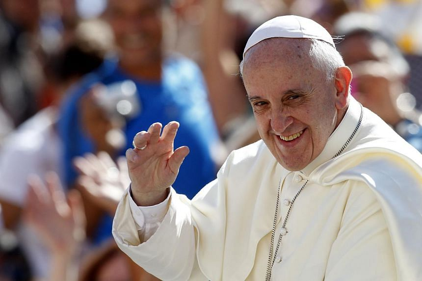 Pope Francis waves to faithful as he arrives for his weekly general audience in St. Peter's square at the Vatican, on Wednesday, Sept 4, 2013. An Argentine archbishop said Pope Francis jokingly told him he chose to live in a simple Vatican residence