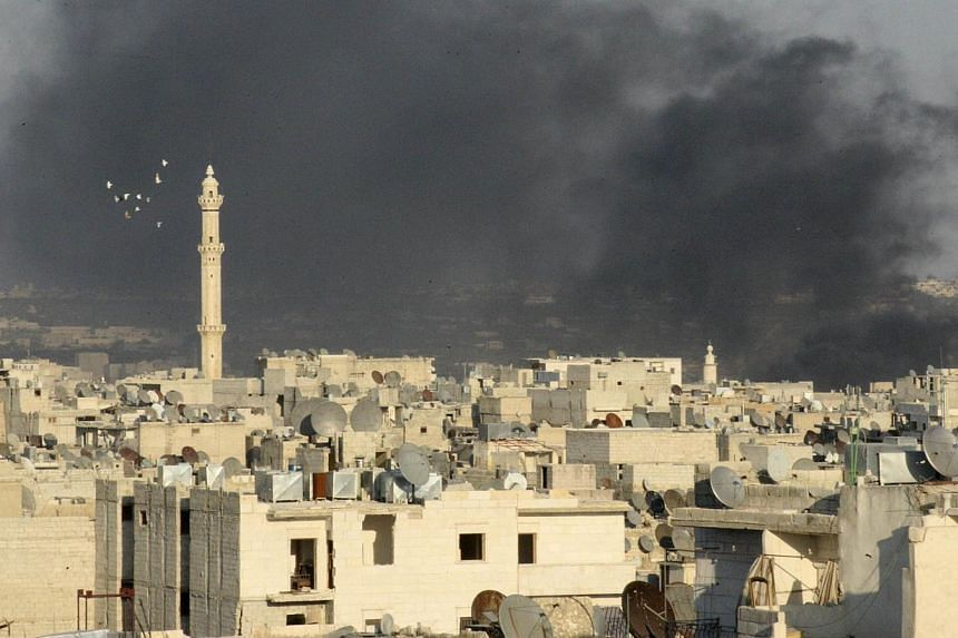Smoke rises as seen from the Aleppo district of Salaheddine on Sept 4, 2013.  The UN is making a desperate new push for a Syria peace conference even as the US prepares a possible military strike, according to diplomats. -- FILE PHOTO: REUTERS