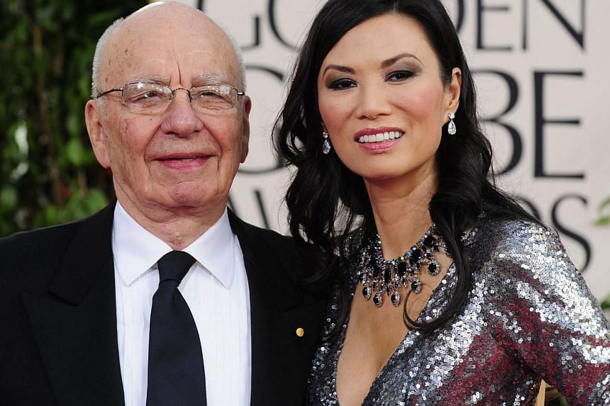 A file photo taken on Jan 16, 2011 shows media tycoon Rupert Murdoch (left) and his wife Wendi Deng (right) arriving on the red carpet for the 68th annual Golden Globe awards in Beverly Hills, California. Australian billionaire Clive Palmer on Sept 5