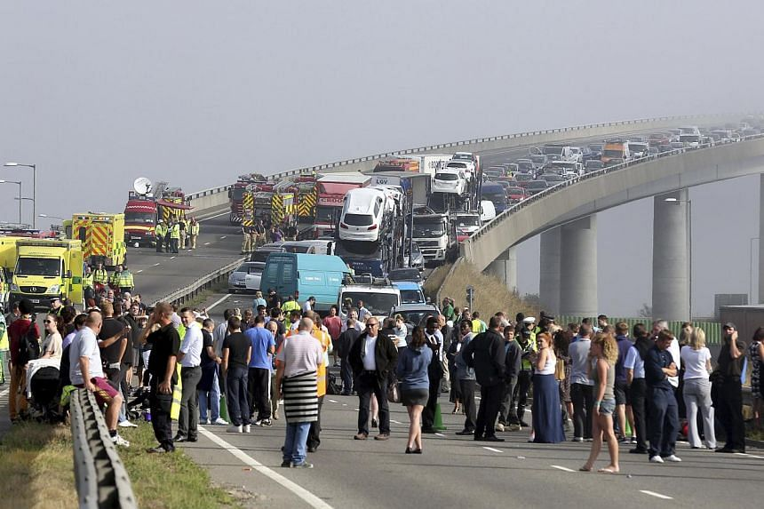 The London-bound carriageway of the Sheppey Bridge Crossing near Sheerness in Kent, south England, following a multi-vehicle collision on Thursday, Sept 5, 2013. -- PHOTO: AP