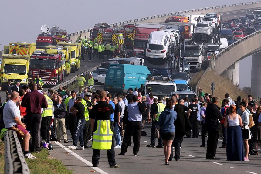 The London-bound carriageway of the Sheppey Bridge Crossing near Sheerness in Kent, south England, following a multi-vehicle collision on Thursday, Sept 5, 2013.Dozens of people were injured, eight of them seriously, in a 100-car crash along th