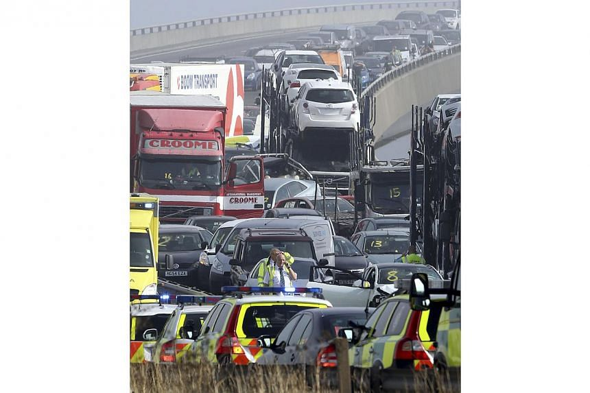 Emergency vehicles attend the scene of a major accident on the Sheppey Bridge Crossing near Sheerness in Kent, south England, following a multi-vehicle collision on Thursday, Sept 5, 2013. -- PHOTO: AP