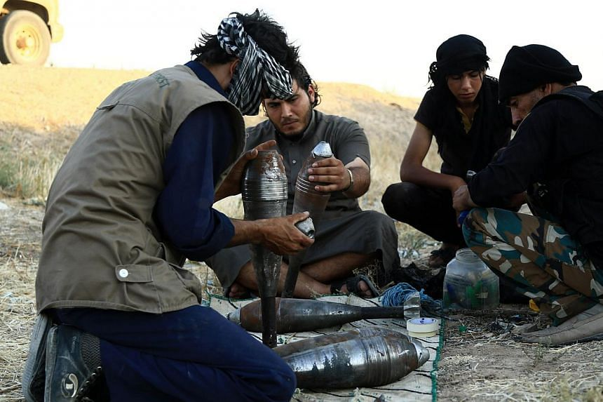 Rebel fighters prepare homemade mortar rounds in the northern Syrian city of Raqqa on Tuesday, Sept 3, 2013. South Korea's Defence Ministry on Thursday, Sept 5, 2013, called for fresh attention to North Korean chemical weapons, suggesting s