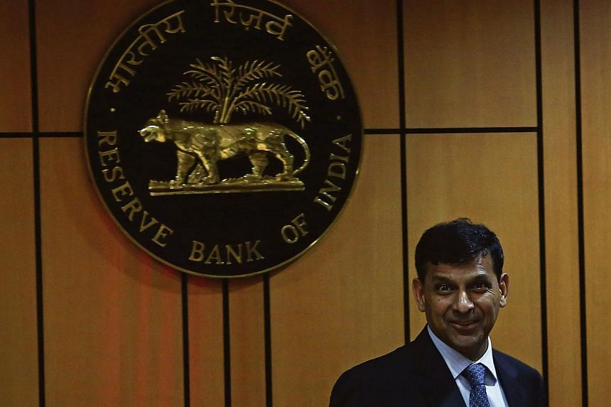 Mr Raghuram Rajan, newly appointed governor of Reserve Bank of India (RBI), arrives for a news conference at the bank's headquarters in Mumbai on Wednesday, Sept 4, 2013. The Indian rupee gained its most in a week on Thursday, Sept 5, 2013, afte