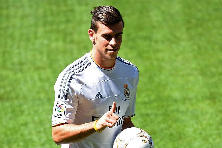 New Welsh striker of Real Madrid Gareth Bale gives the thumbs-up as he poses on the pitch during his presentation at the Santiago Bernabeu stadium in Madrid on Sept 2, 2013.Gareth Bale said his drawn-out move to Real Madrid for a world-re