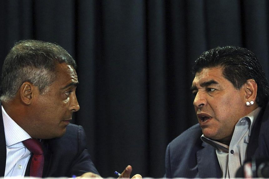 Retired Argentine football player Diego Maradona (right) chats with Brazil's congressman and former football star Romario during a news conference in Sao Paulo on Wednesday, Sept 4, 2013. Former rivals Maradona and Romario have joined force