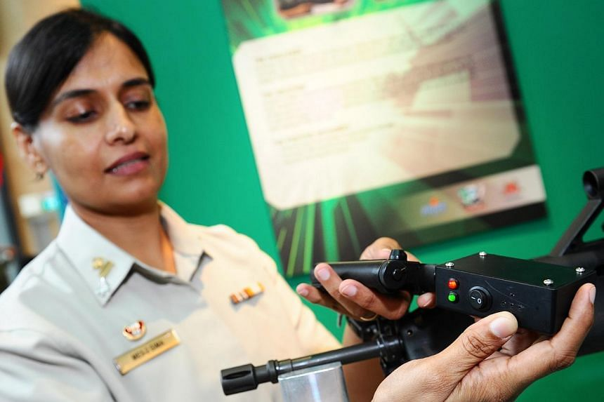 ME5 Sima Rai, Commander of 6th Army Maintenance Base, with the Infra-Red Inspection Kit for Laser Aiming devices. -- PHOTO: MINDEF