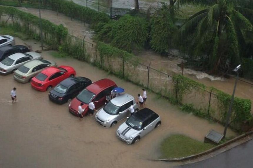 Flooding at ACS(I). Many parts of Singapore reported moderate to heavy thundery showers on Thursday morning, resulting in flash floods and traffic jams in some areas. -- PHOTO: READER ALEX LEE