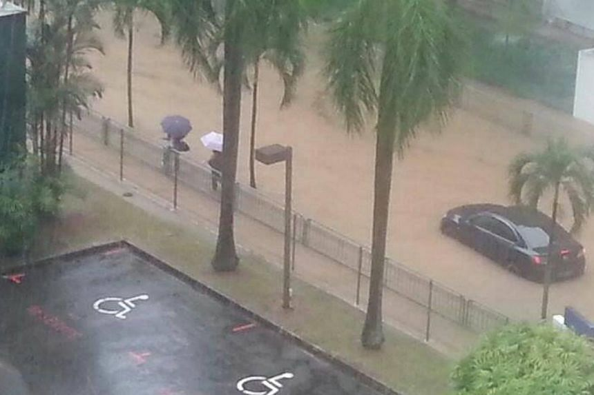 Traffic at a standstill near Commonwealth MRT. Many parts of Singapore reported moderate to heavy thundery showers on Thursday morning, resulting in flash floods and traffic jams in some areas. -- PHOTO:READER ANDREW LUM