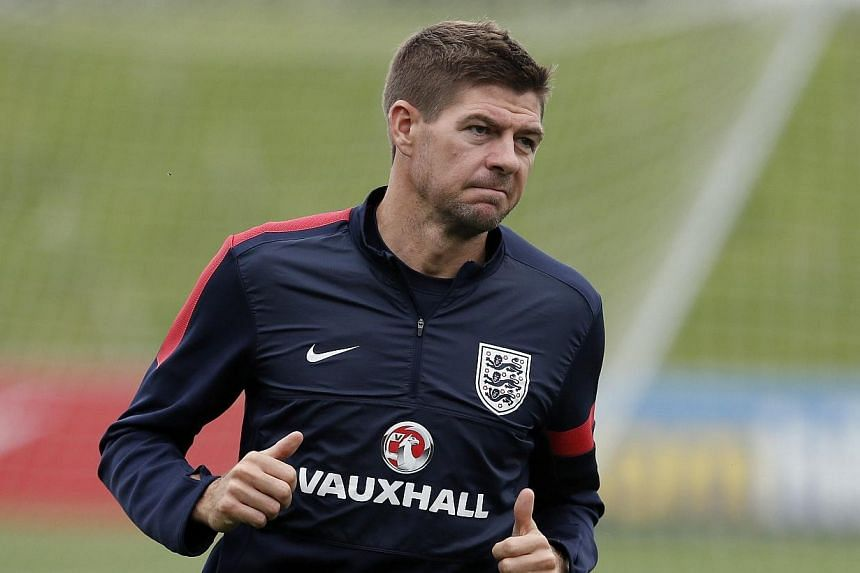 Steven Gerrard warms up during a training session with England at the St George's Park training complex near Burton upon Trent on Sept 3, 2013. TheLiverpool captain says he dreams of managing the football club, after revealing that he intends t