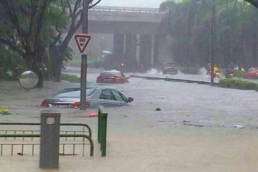 Flooding at ACS(I). Many parts of Singapore reported moderate to heavy thundery showers on Thursday morning, resulting in flash floods and traffic jams in some areas.-- PHOTO: FACEBOOK/MINSOON LEE