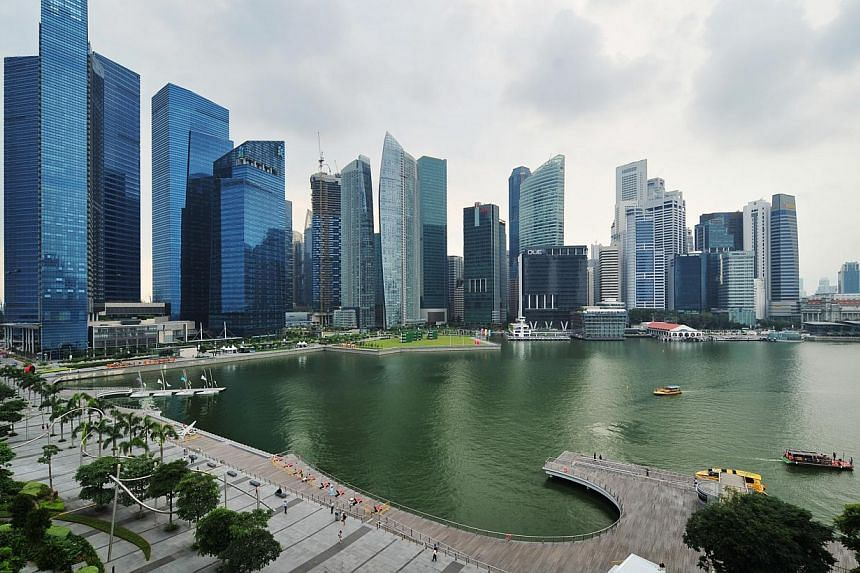 A sterling showing in the second quarter has made economists more upbeat over Singapore's full-year growth prospects, even as they expect slower growth from manufacturing. -- ST FILE PHOTO: ALPHONSUS CHERN